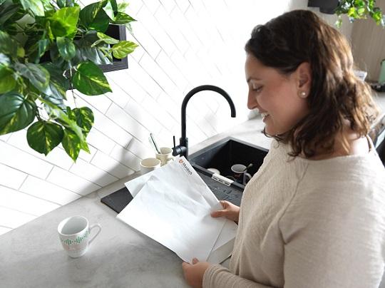 Genna Radnan looking at her Murdoch University admission letter