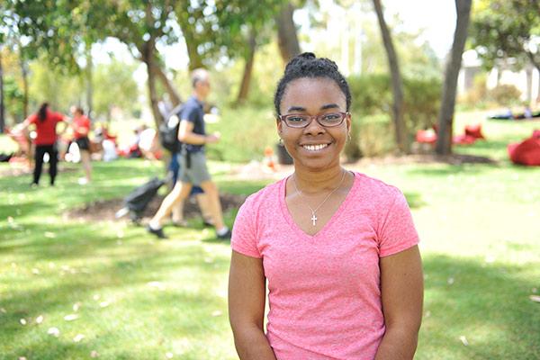 International student Lisa Walkes in Bush Court smiling at camera