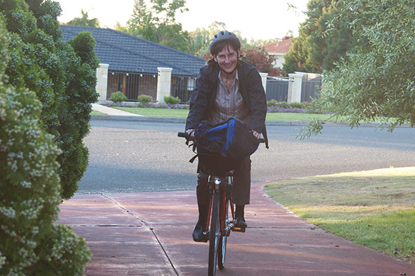 Martina Calais riding on bike in suburbs