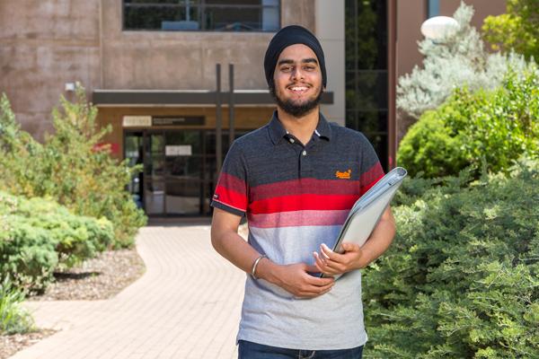 Mehtab Singh holding books