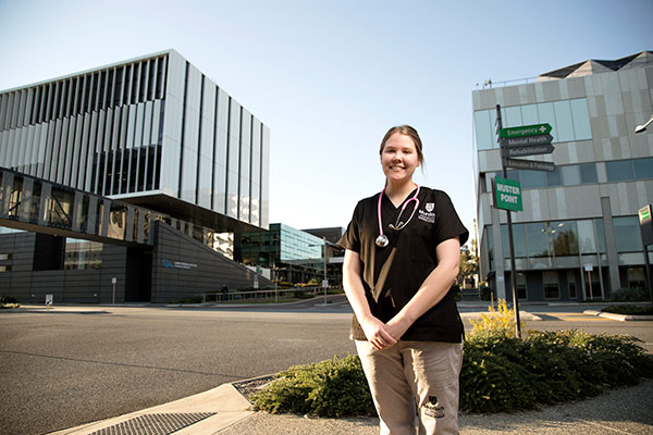 Murdoch nursing student standing in the Murdoch health precinct
