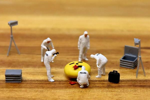 Toy figurines are assembled to create a mock crime scene