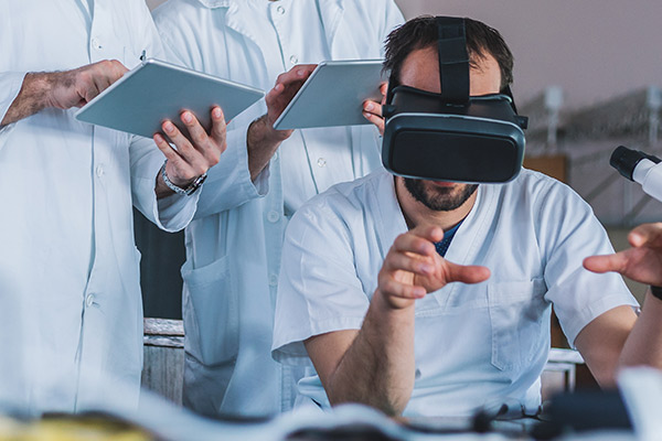 Medical professional in lab with VR headset on