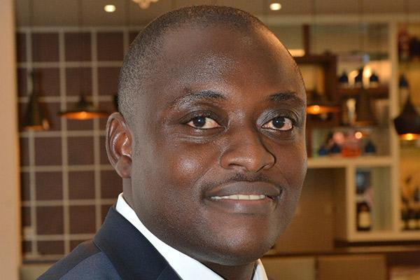 International student Samuel Okang-Boy smiling at camera