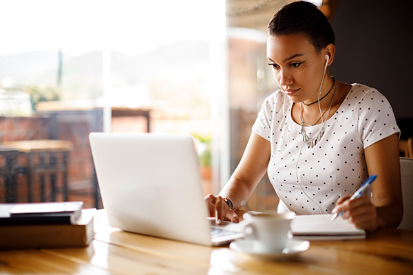 Girl using a laptop at a table