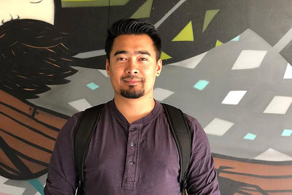 Sreej Pradhan posing in front of wall